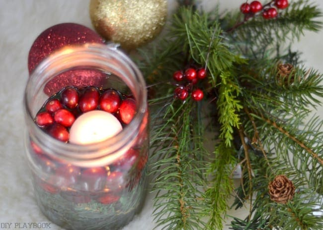 The mason jar Christmas candle holder is a great table centerpiece.