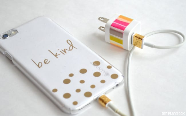 Using bright tape to customize your phone charger is such a fun idea.