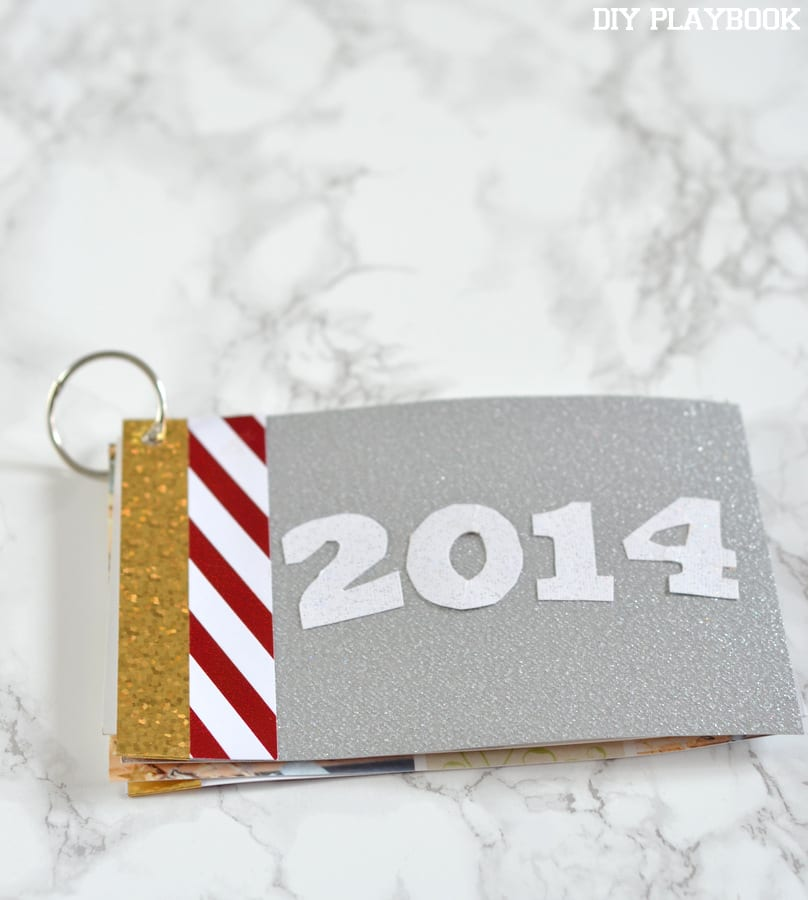 Next, add a fun cover to your Christmas Card photo book. We love this glittery silver paper!