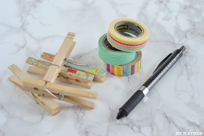 Clothes pins, pens and washi tape are all you need to organize your cords.