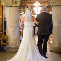 A father walking her daughter down the aisle is a special wedding moment.