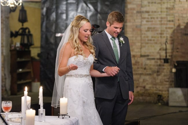 Holding hands with your fiance on your wedding day is a happy time.