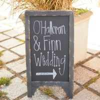 This mini sign directing guests to the wedding is a cute decor addition.