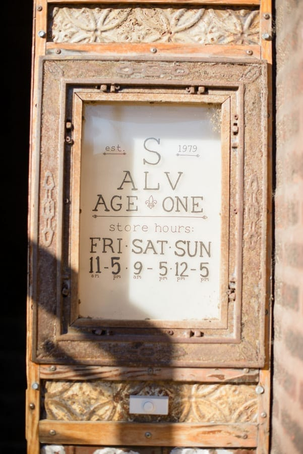 This antique store sign is a rustic and vintage looking.