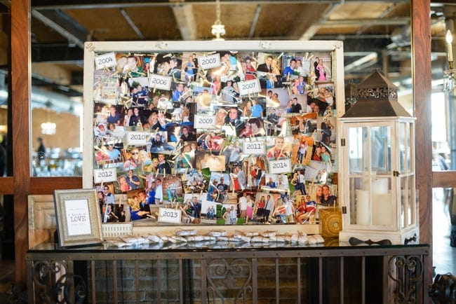 This photo wall adds a personalized touch to the wedding decor.