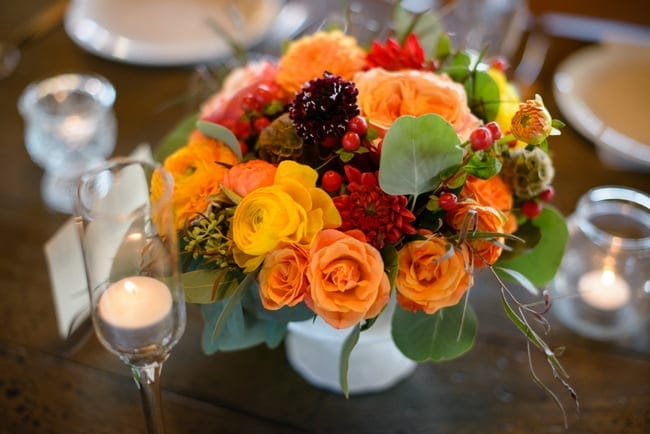 These flower center pieces are the perfect fall colors.