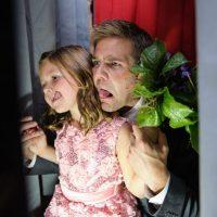 A photo booth is a fun wedding reception activity for kiddos.