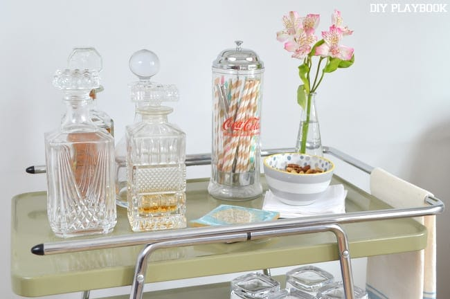 One of our favorite bar cart accessories are the old fashion decanters we have found at thrift stores.
