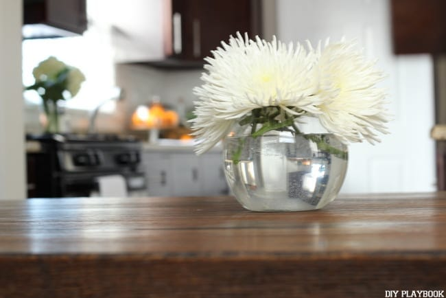 Flowers in a bowl vase look great in any space