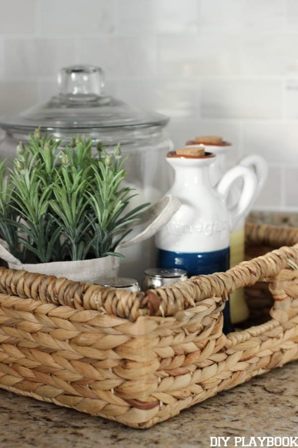 This wicker kitchen basket is great for storing salt, pepper, herbs and more.