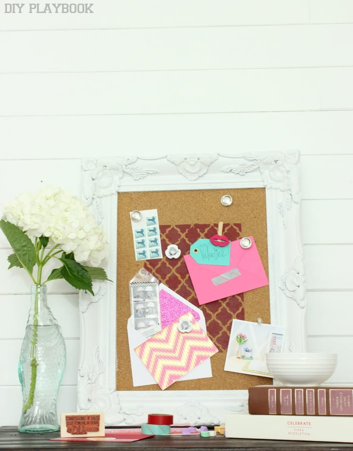 This stenciled cork board is great for hanging any sort of picture or card.