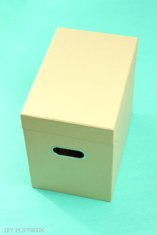 Put a lid on your filing clutter in a cute box like this one from Target!