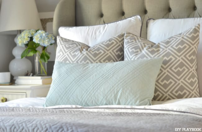 Mixing textured throw pillows adds an interesting design element to the space.