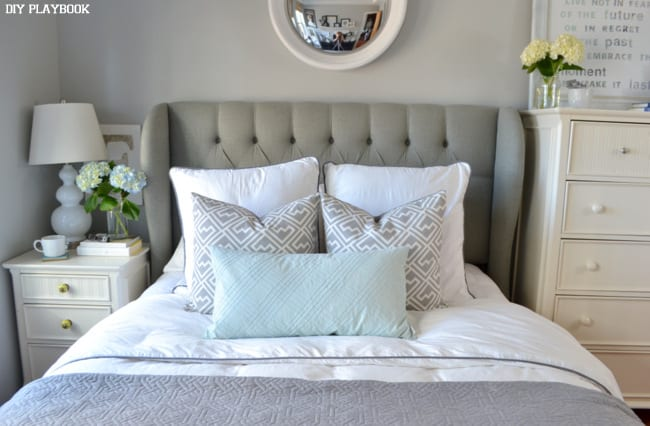 The accent pillows with the gray duvet and headboard look adorable.