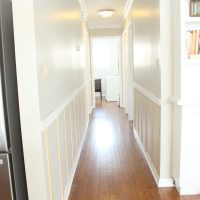 This board and batten hallway is a nice addition to the home.