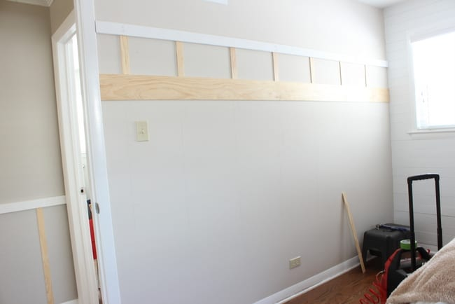 Board and Batten DIY tutorial - adding the smaller vertical pieces.