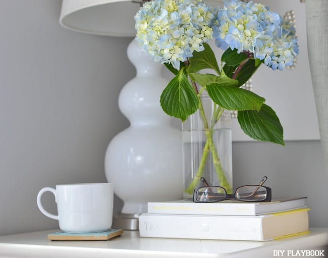The fresh flowers and white hardware create a calming feeling in this bedroom.