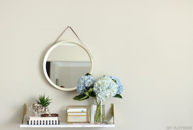 Pair the shelf with some accents, a mirror, and the whole room has a new look