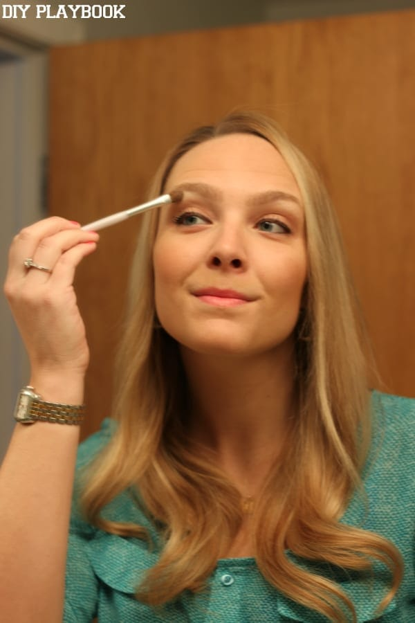 Casey defines her brows with a touch of highlighter on the brow bone