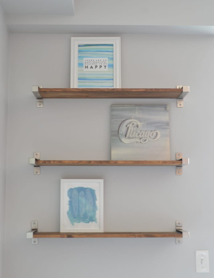 Layer shelves with frames in the background.