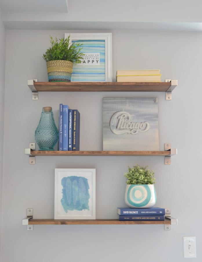Add in plants for a pop of green color on your shelves--use fake plants for low maintenance.