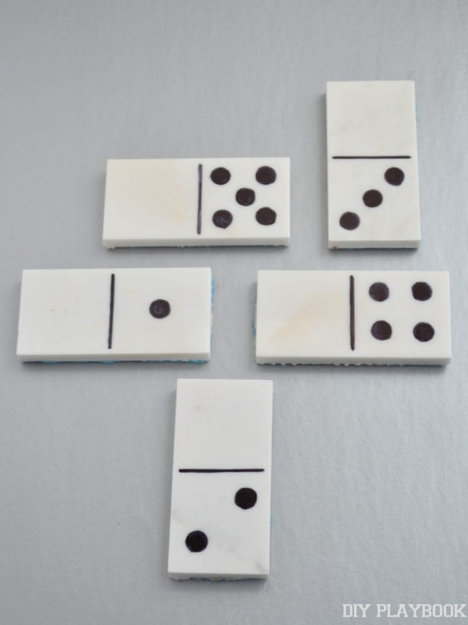 Draw on any design using the sharpie onto the blank marble tiles to make domino pieces.