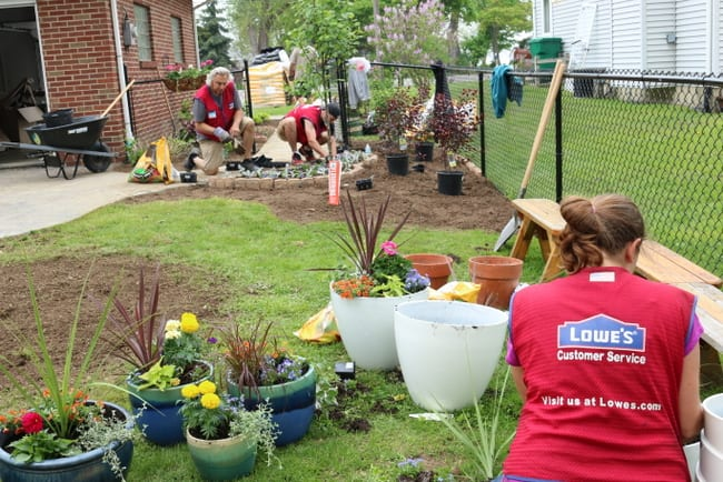 Lowe's volunteers working on the landscaping