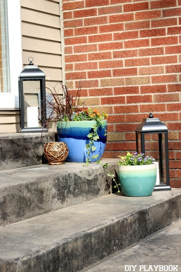 Add lanterns and flower pots to your stairs