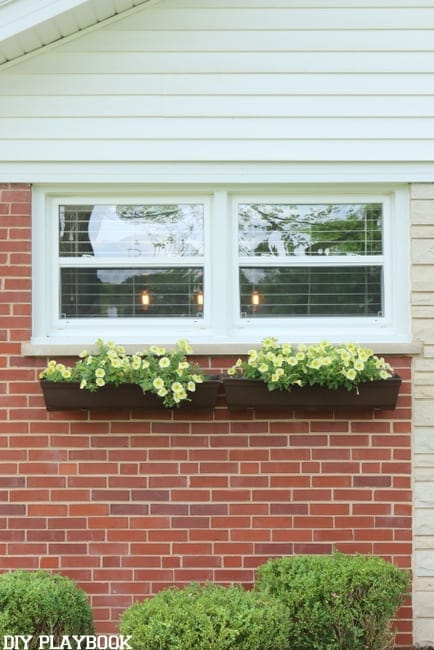 Add fresh flowers to the DIY flower boxes.