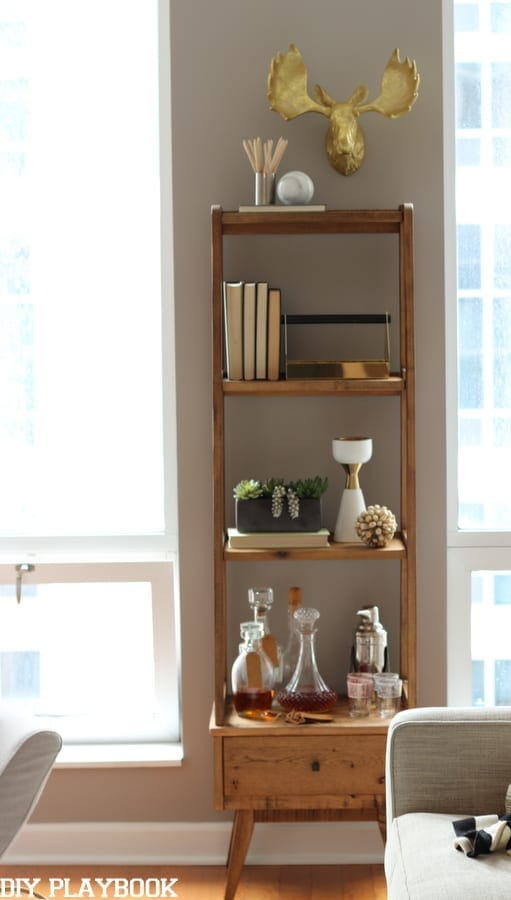 This wooden shelving unit is perfect for a mini bar or for books.