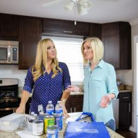 Bridget and Casey have a conversation in the kitchen for the Liberty Mutual video.