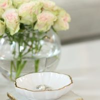 White roses in a bowl vase