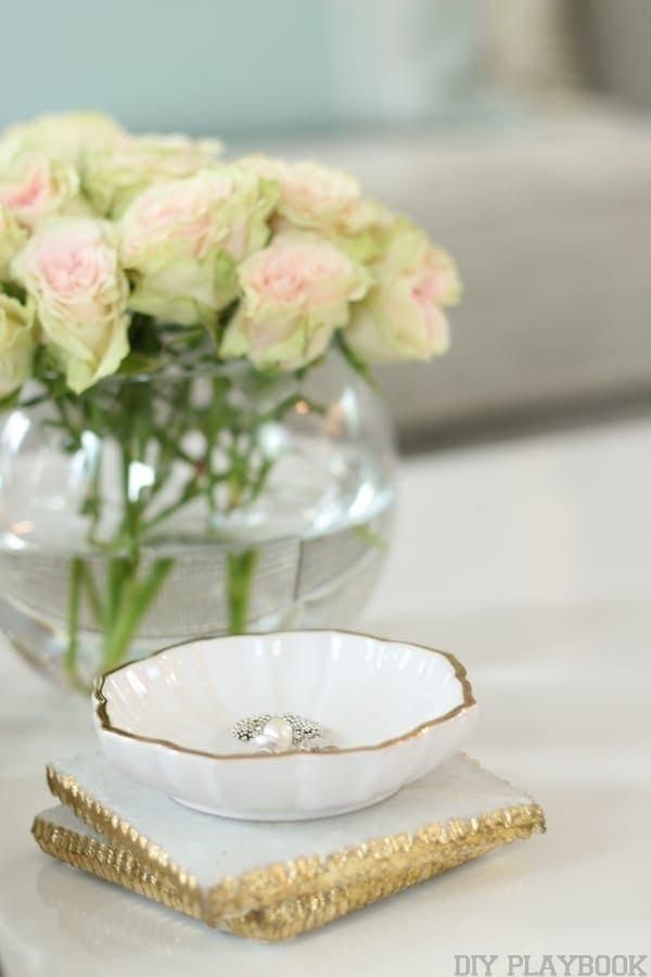 White roses in a bowl vase