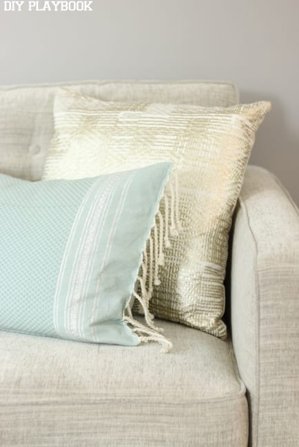 Soft colored throw pillows look beautiful on a greige couch.
