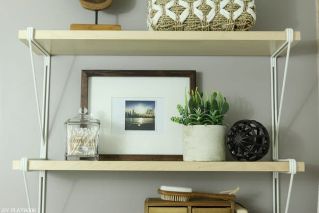 Use actual bathroom accessories:How to Style Your Bathroom Shelves: Easy DIY | DIY Playbook