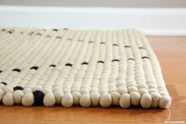 this neutral felt ball rug has a simple design perfect for any style decor