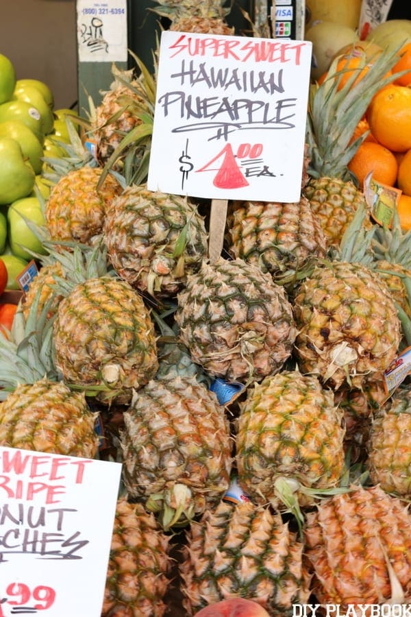 Pike Place market is full of all kinds of delicious goodies - like pineapples!