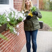 Casey adds fresh flowers to her home's exterior.