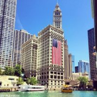The Chicago flag pops against the river in the summertime.