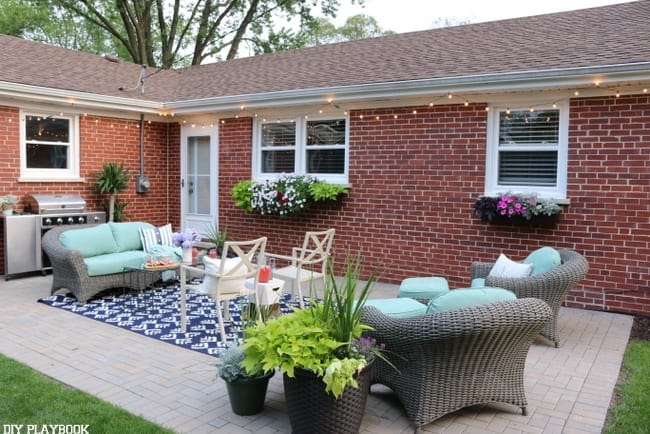 This beautifully decorated backyard is colorful with tons of open space.