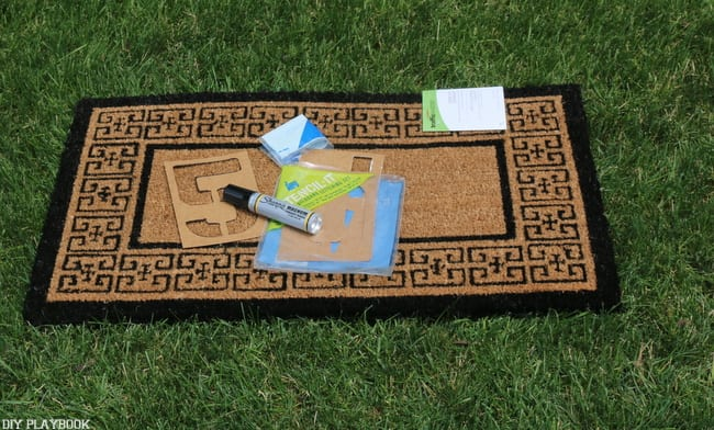 All you need for this project is a plain doormat, a permanent marker and some stencils
