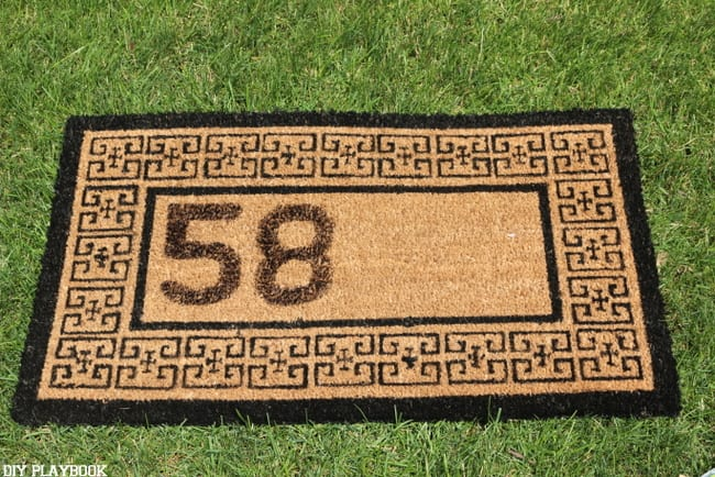 This personalized doormat is half finished, just a few more numbers