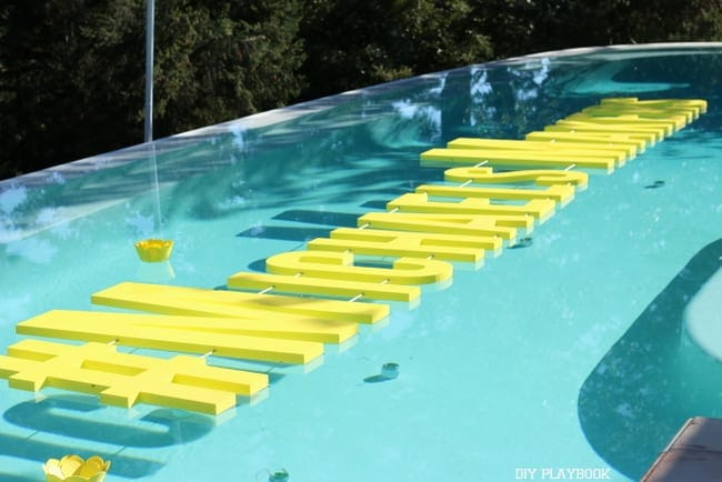 These letter pool floaties are fun decor pieces.