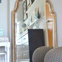 This large mirror has elegant gold rims.