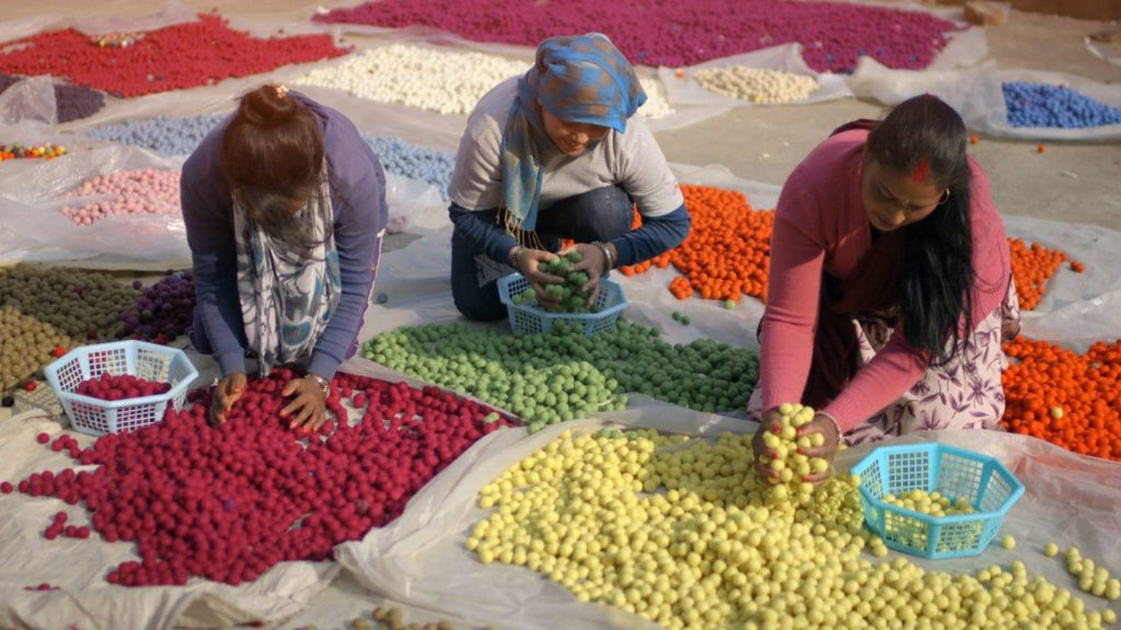 this felt ball rug company employs women to empower and enable them to succeed