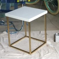 This chic end table is sleek and painted gold.
