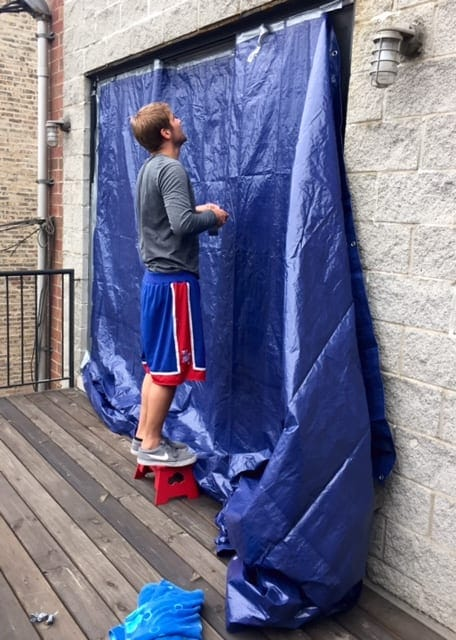 Finn had to cover our glass door with a big, blue tarp to prevent any further water damage to our new stained hardwood floors!