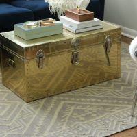 This renovated gold trunk is great for storage.