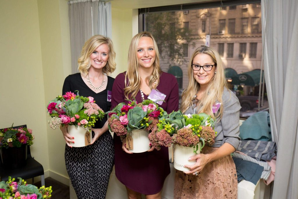Bridget, Casey, and Jessica after their flower making class