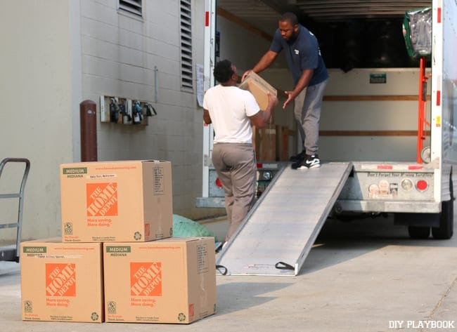 These movers help load boxes onto the truck.